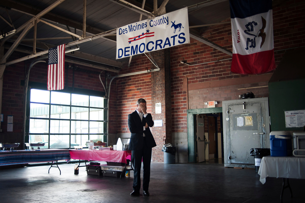 Democratic U.S. presidential candidate Maryland Governor Martin O'Malley listens to his introduction as he prepares to speak at the Des Moines County Democrats' fundraiser in Burlington, Iowa on November 7, 2015.