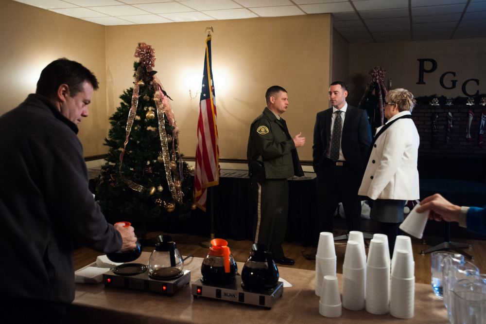 Attendees, including the local sheriff, mingle before Republican U.S. presidential candidate Marco Rubio's town hall event in Pella, Iowa on December 30, 2015.