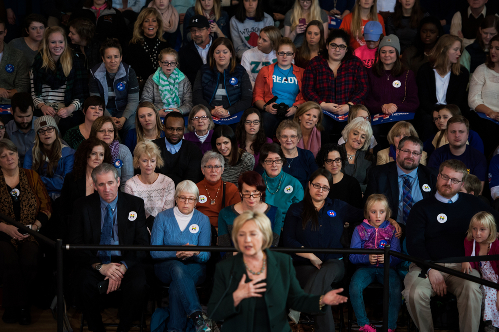 Supporters watch as Democratic U.S. presidential candidate Hillary Clinton speaks during a town hall at Old Brick Church in Iowa City, Iowa on December 16, 2015.