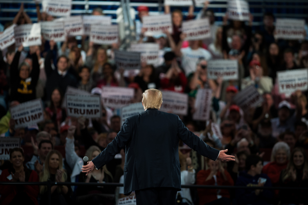 Republican U.S. presidential candidate Donald Trump turns to the crowd behind him during a campaign event in Des Moines, Iowa on Friday, Dec. 11, 2015.