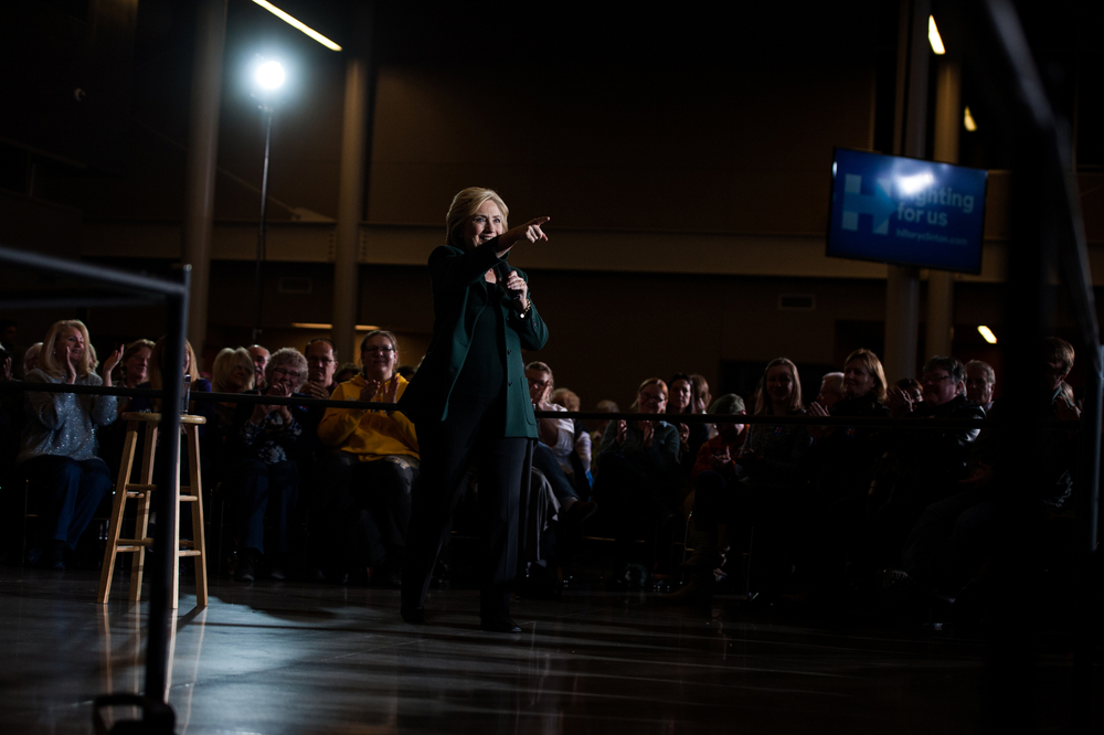 Democratic U.S. presidential candidate Hillary Clinton points to a question in the audience at a campaign event at Clinton Middle School in Clinton, Iowa on November 22, 2015.