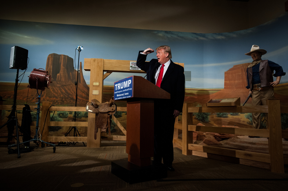 Republican U.S. presidential candidate Donald Trump looks out into the crowd for his Iowa campaign manager while speaking press conference at the John Wayne Birthplace and Museum in Winterset, Iowa on January 19, 2016.