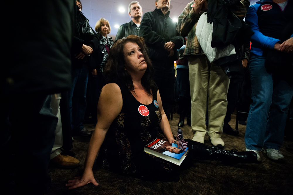 Debra Sage, a supporter of U.S. Republican presidential candidate Ted Cruz, from Grinnell, Iowa listens as Cruz speaks at a campaign stop at a Pizza Ranch restaurant in Newton, Iowa on November 29, 2015.