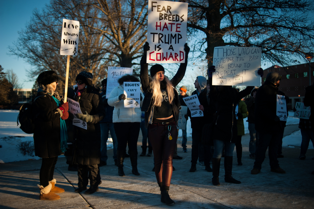 Protestors carry signs and chant before a campaign event for Republican U.S. presidential candidate Donald Trump at University of Northern Iowa in Cedar Falls, Iowa on January 12, 2016.