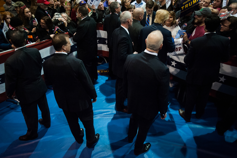 The U.S. Secret Service detail for Republican U.S. presidential candidate Donald Trump stands watch as he signs autographs at a campaign event at University of Northern Iowa in Cedar Falls, Iowa on January 12, 2016.