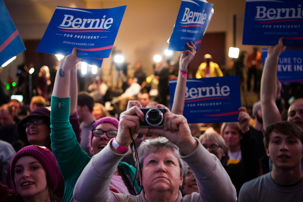 A woman photographs the podium before Democratic U.S. presidential candidate Bernie Sanders' speech a rally on caucus night in Des Moines, Iowa February 1, 2016.