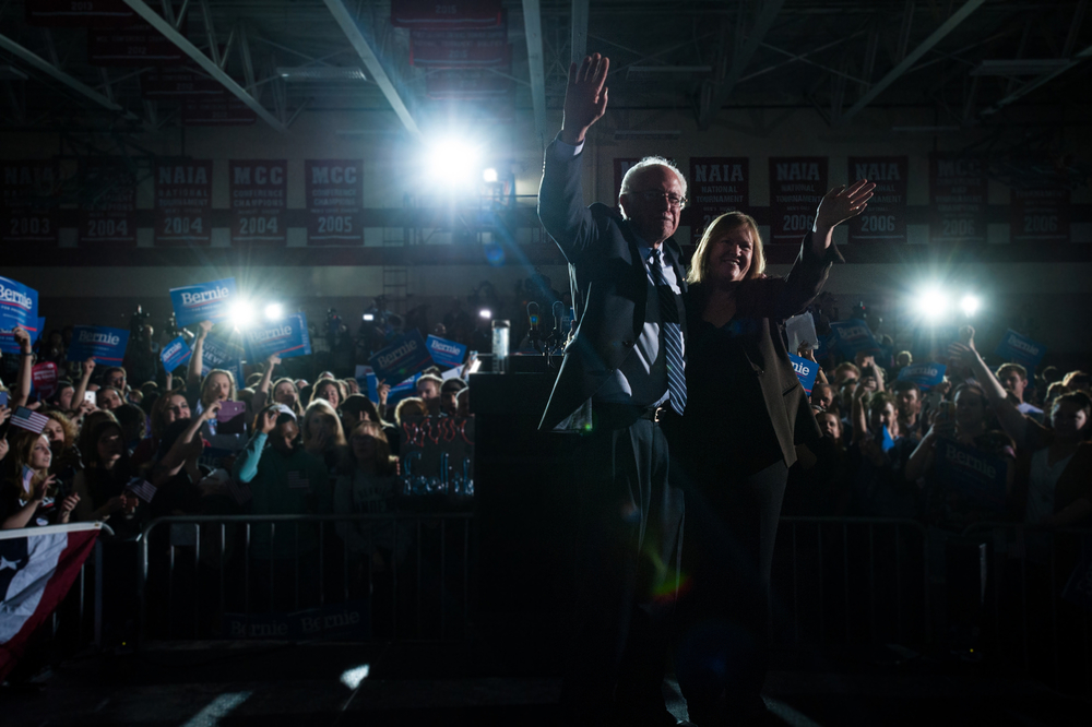 Democratic U.S. presidential candidate Bernie Sanders and his wife Jane wave to the crowd after a campaign rally in Des Moines, Iowa the night before the Iowa caucuses on January 31, 2016.
