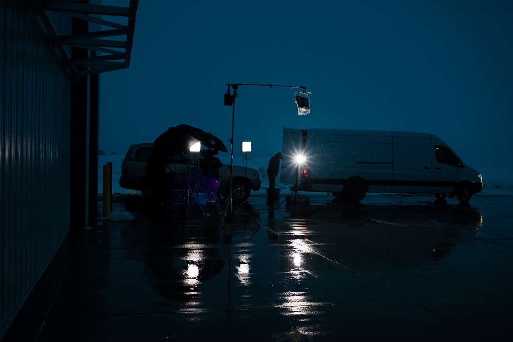 An ABC News crew sets up for a live broadcast in the rain Republican U.S. presidential candidate Ted Cruz speaks inside a hangar at the Webster City Municipal Airport in Webster City, Iowa on January 7, 2016.
