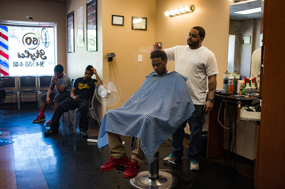 TJ gets a haircut in Ferguson.