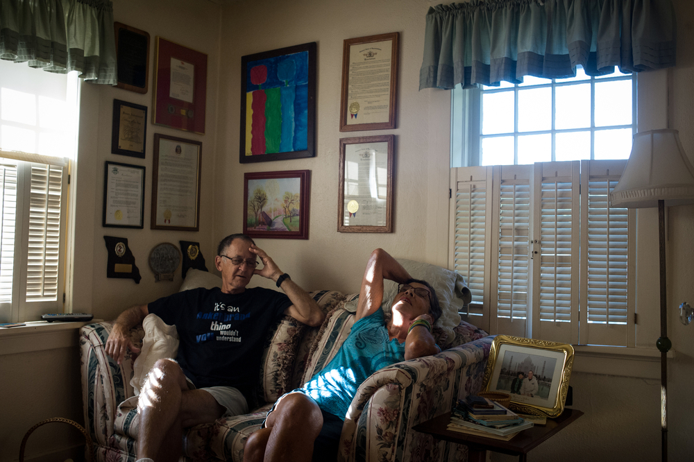 Ank and Susan Ankenbrand discuss their evening plans while relaxing in the study of their home in an historic neighborhood of Ferguson. Susan was a councilwoman in Ferguson for 16 years and Ank, a college professor, was on the school board for some time as well.