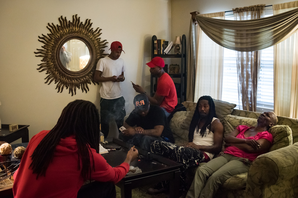 Friends hang out at the condo of Carlette Williams (right) at the Brentwood Townhomes in Ferguson, Mo. William's sons' friends are the sons of many of her former drinking and smoking buddies from when she was that age.