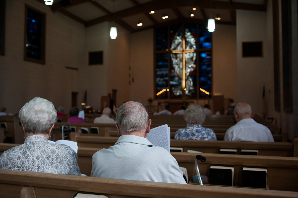 Members of the congregation worship at Zion Lutheran Church, a predominantly white parish. The congregation is largely over 60, with the only children in the congregation coming from the few black families that changed churches after the closing of another Lutheran church in Kinloch, Missouri.