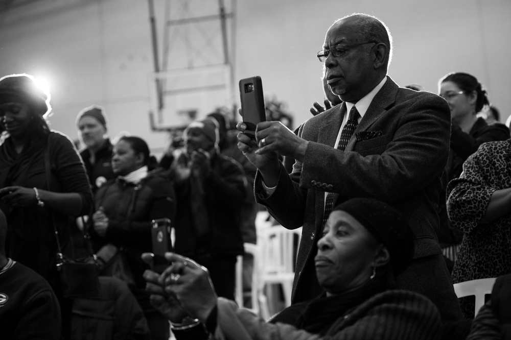 People photograph as Democratic presidential candidate Bernie Sanders takes the stage at an African-American Community Conversation town hall event in Milwaukee, Wisconsin on April 2. Sanders struggled behind opponent Hillary Clinton to garner the support of the black community, losing most southern states.