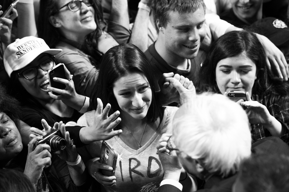 A young woman, who spent much of the rally crying with joy, gazes as she holds the hand of Democratic presidential candidate Bernie Sanders after a rally at Temple University in Philadelphia, Pennsylvania on April 6.