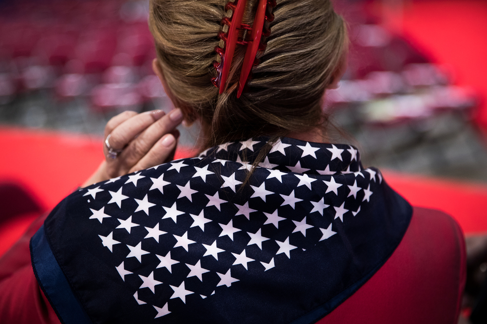 A woman fixes her hair at the Republican National Convention in Cleveland, OH.
