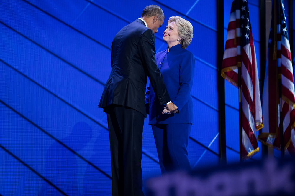 President Barack Obama and Democratic U.S. presidential nominee Hillary Clinton speak on stage after Obama spoke at the Democratic National Convention Philadelphia, PA.
