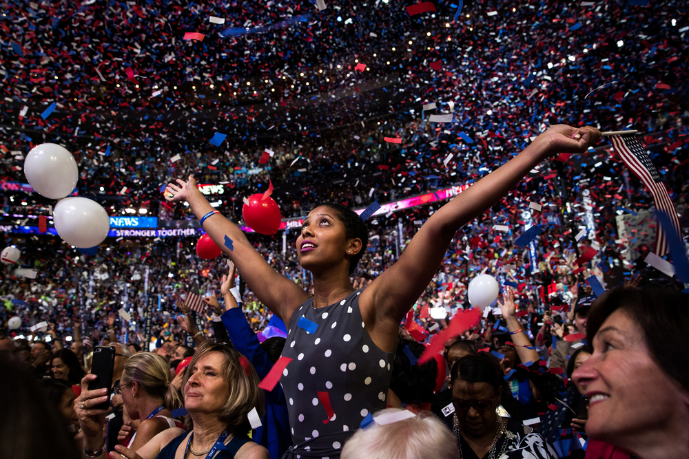A New York delegate looks up as confetti and balloons fall after Democratic U.S. presidential nominee Hillary Clinton accepted the nomination on the last night of the Democratic National Convention in Philadelphia, PA.