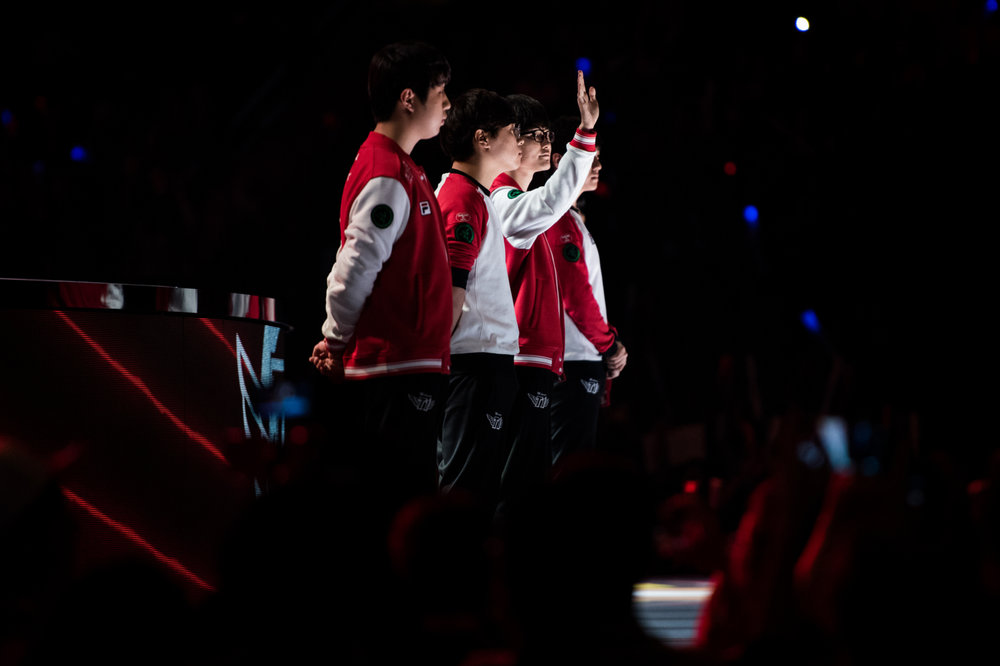 "Lee ""Faker"" Sang-hyeok, second from right, likely the greatest player in the history of League of Legends, waves to the crowd ahead of his team's semifinal match."