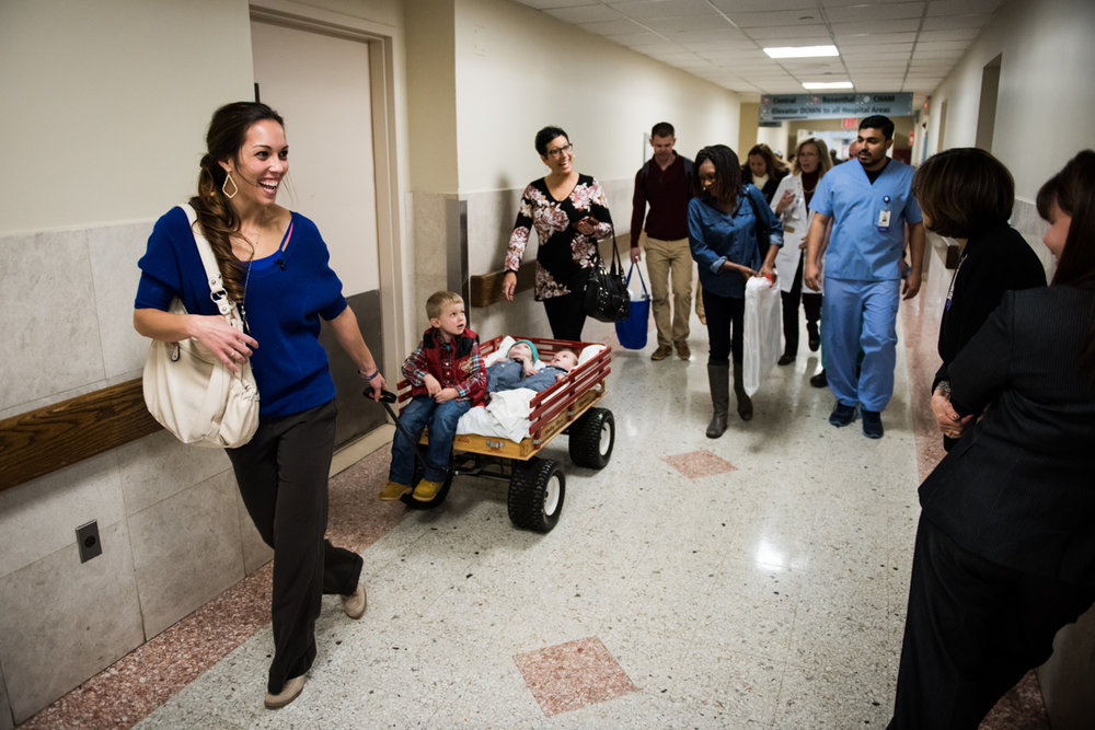Nicole McDonald pulls a red wagon carrying her twin boys Jadon and Anias as they leave their hospital room for the first time for anything other than a medical procedure at Montefiore Children's Hospital in The Bronx, New York, N.Y. on December 13, 2016.