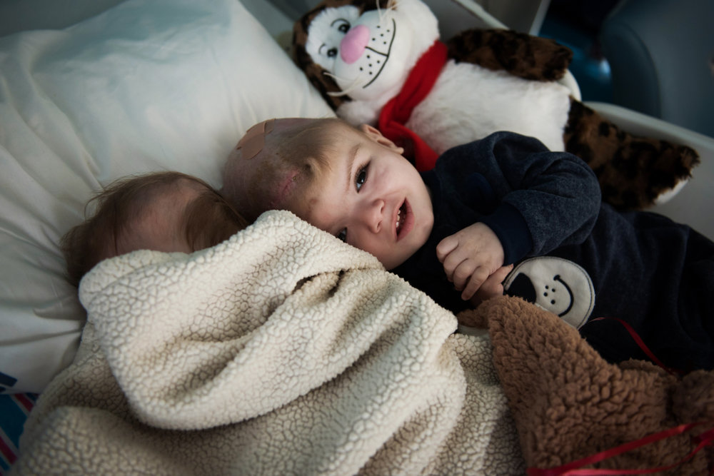Anias McDonald lays next to his sleeping brother Jadon at Montefiore Children's Hospital in The Bronx, New York, N.Y. on December 14, 2016.