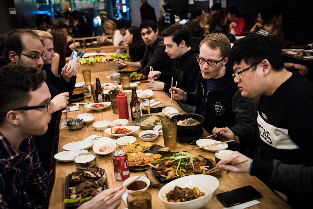 H2k-Gaming team members and staff eat dinner together at their post-match team meal at a Korean barbecue restaurant in New York, NY. This would be one of the last times the team would be together.