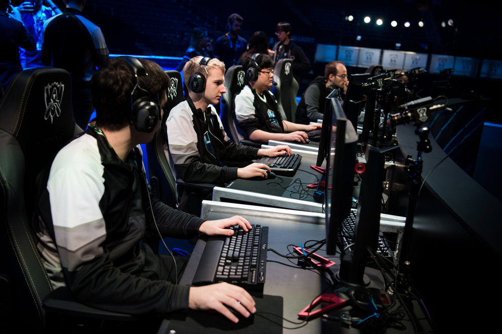 H2k checks their computer settings and headphone levels during a rehearsal on state at Madison Square Garden. Players wear noise-canceling headphones with white noise pumped in to cancel out most of the crowd reaction while still being able to communicate.
