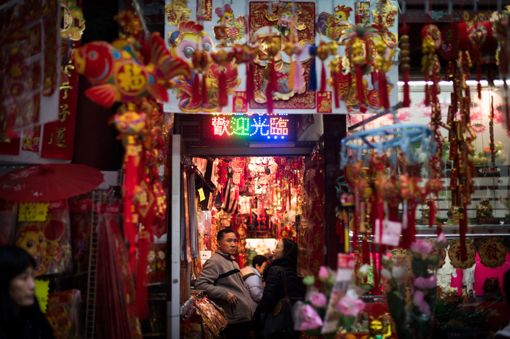 A man stands in a store selling decorations and other items in preparation for Chinese New Year in the Chinatown neighborhood of Manhattan in New York, NY.