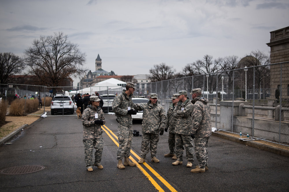 National Guard soldiers stand near an entrance to the national mall on the day of Donald Trump's inauguration as the 45th President of the United States in Washington, D.C., on January 20, 2017. Credit: Mark Kauzlarich for CNN