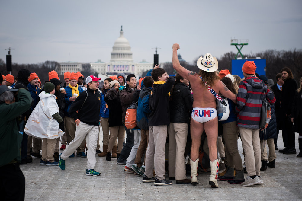 "Robert John Burck, better known as ""The Naked Cowboy"", sings to a group of young students before President Donald Trump's inauguration as the 45th President of the United States in Washington, D.C., on January 20, 2017. Credit: Mark Kauzlarich for CNN"