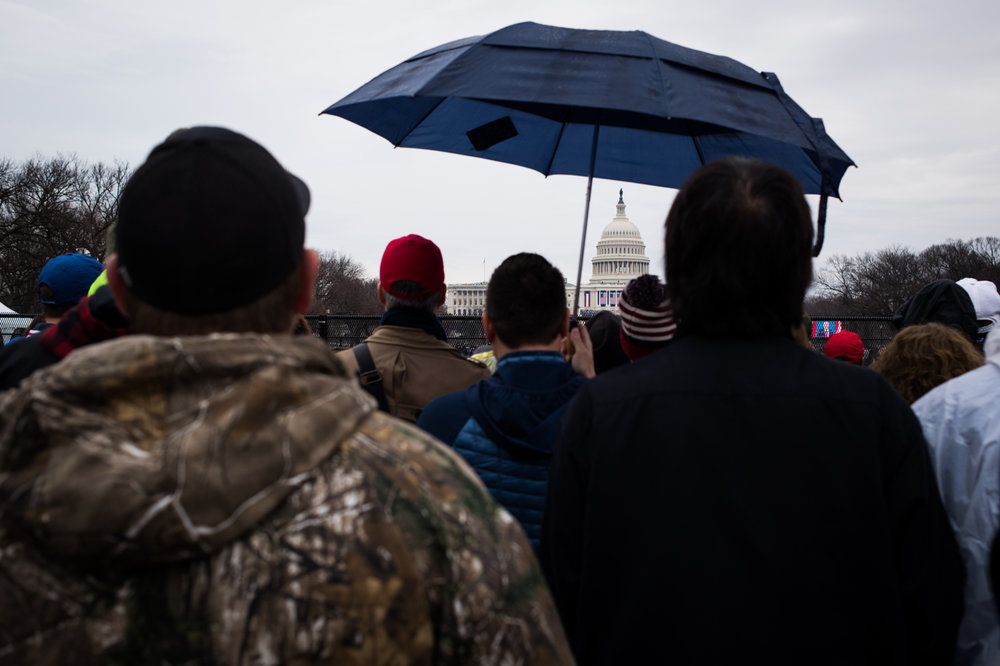 People look toward the U.S. Capitol during President Donald Trump's inauguration as the 45th President of the United States in Washington, D.C., on January 20, 2017. Credit: Mark Kauzlarich for CNN