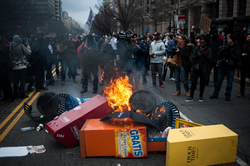 Anarchist protestors start garbage cans and newspaper dispensers after Donald Trump's inauguration as the 45th President of the United States in Washington, D.C., on January 20, 2017. Credit: Mark Kauzlarich for CNN