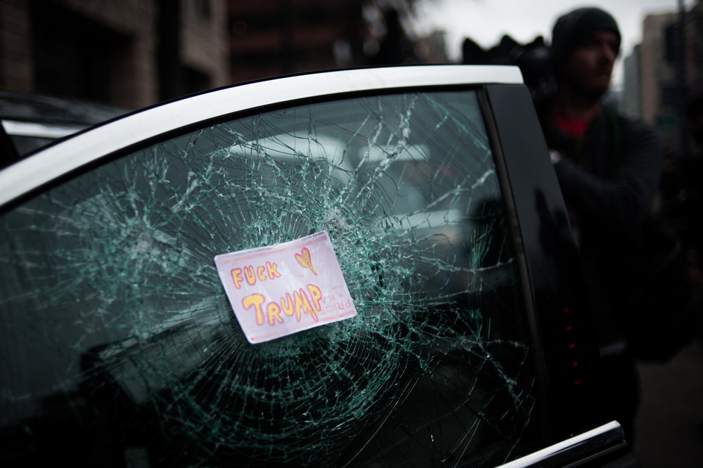 A sticker is placed over a shattered window of a limousine after Donald Trump's inauguration as the 45th President of the United States in Washington, D.C., on January 20, 2017. Credit: Mark Kauzlarich for CNN