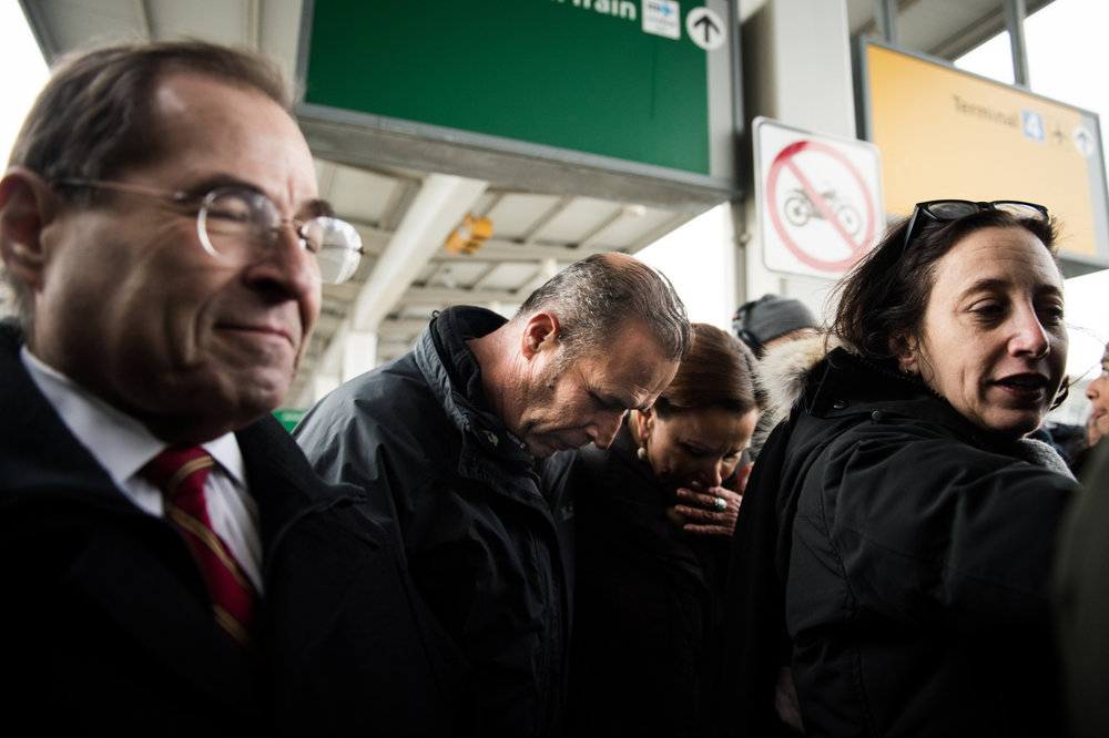 Hameed Khalid Darweesh, center, leaves at John F. Kennedy International Airport surrounded by Congressmen Jerrold Nadler, left, and Congresswoman Nydia Vel�zquez, second from right, in New York, NY on Saturday, January 28, 2017. Credit: Mark Kauzlarich for CNN