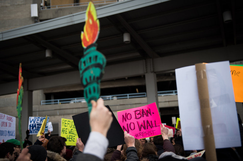 Protestors gather in a parking lot outside John F. Kennedy International Airport in New York, NY on Saturday, January 28, 2017. Credit: Mark Kauzlarich for CNN