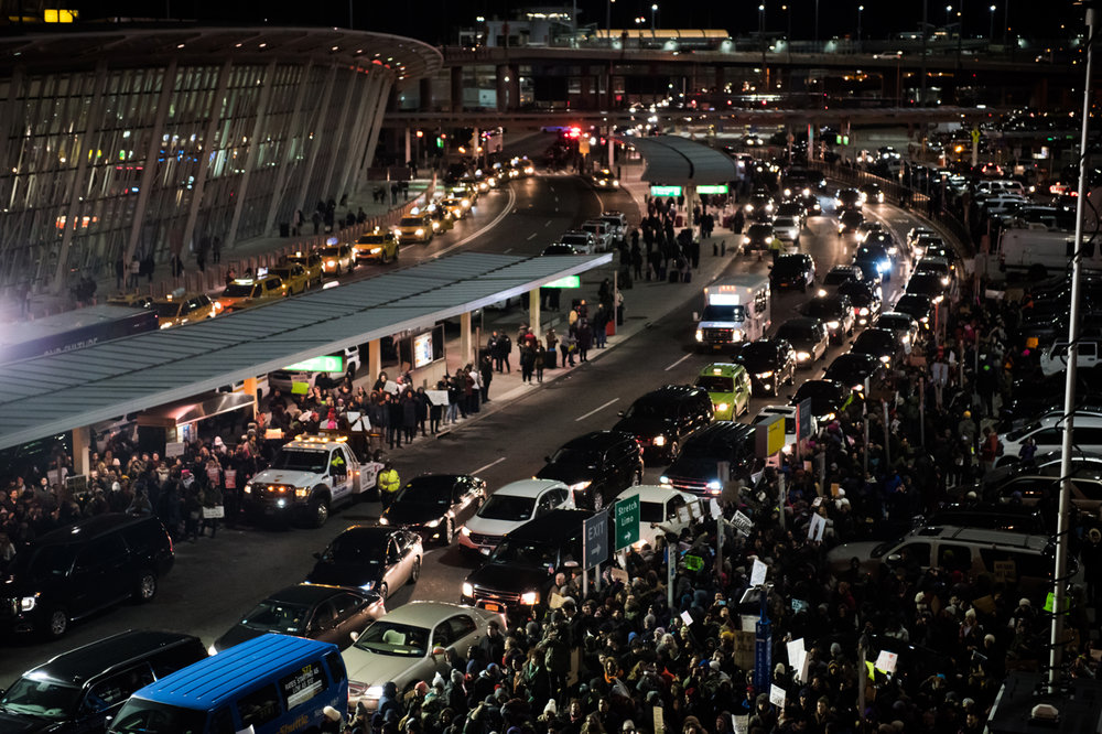 Protestors crowd near the road at Terminal 4 at John F. Kennedy International Airport in New York, NY on Saturday, January 28, 2017. Credit: Mark Kauzlarich for CNN