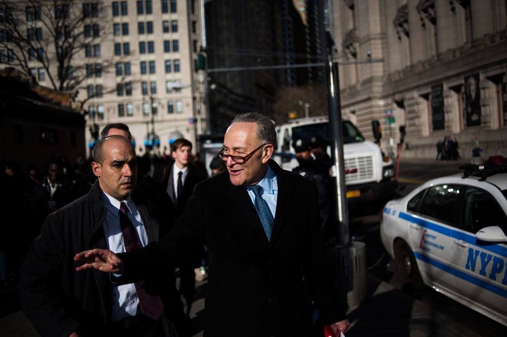 Senator Charles Schumer (D-NY) walks past Battery Park during a protest in support of refugees in New York, NY on Saturday, January 29, 2017. Credit: Mark Kauzlarich for CNN