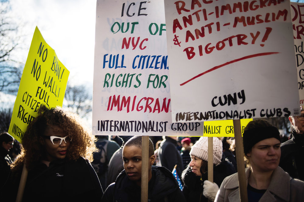 Protestors hold signs in support of immigrants prior to marching from Battery Park to Federal Plaza in the Manhattan borough of New York, NY on Saturday, January 29, 2017. Credit: Mark Kauzlarich for CNN