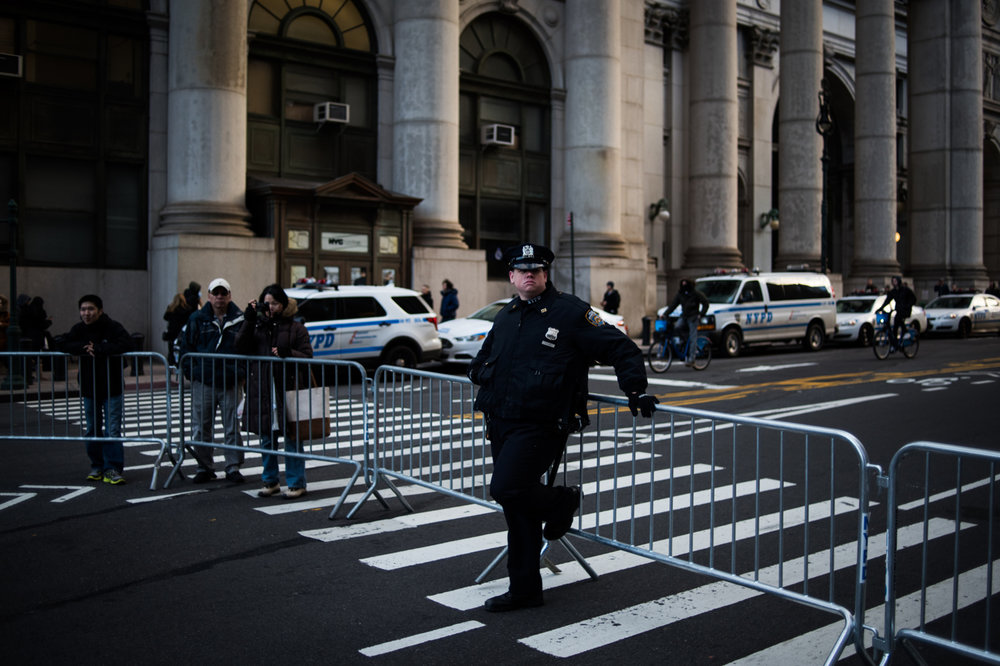 An NYPD officer watches as protestors march from Battery Park to Federal Plaza in the Manhattan borough of New York, NY on Saturday, January 29, 2017. Credit: Mark Kauzlarich for CNN