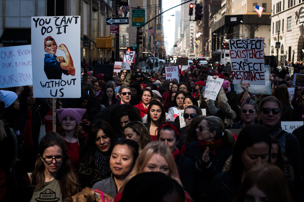 A crowd, largely of women, fills a barricaded space along 5th Avenue during an International Women's Day rally and march in New York, NY on March 8, 2017. CREDIT: Mark Kauzlarich for CNN