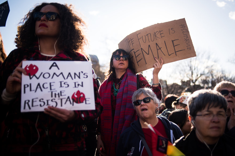 People attend an International Women's Day rally and march at Washington Square Park in New York, NY on March 8, 2017. CREDIT: Mark Kauzlarich for CNN