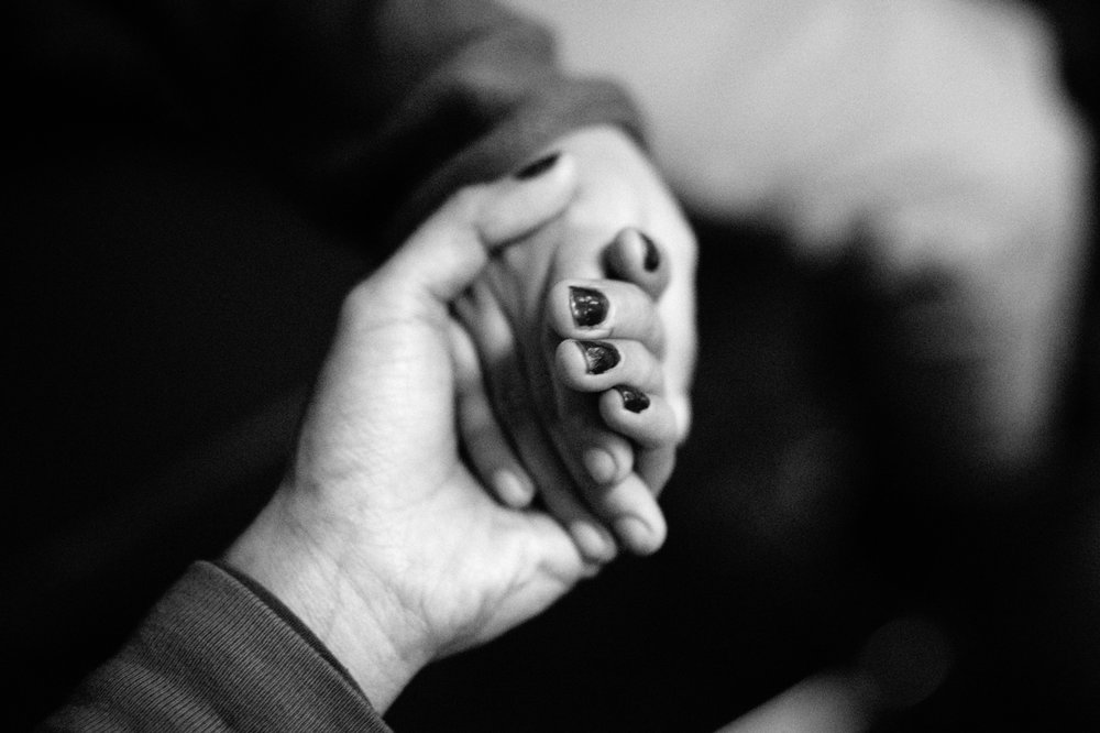 Margarita, an undocumented immigrant from Mexico, holds her young daughter Katie's hand after an interview while waiting to see lawyers at Catholic Charities Community services in New York, NY on March 9, 2017. CREDIT: Mark Kauzlarich for CNN