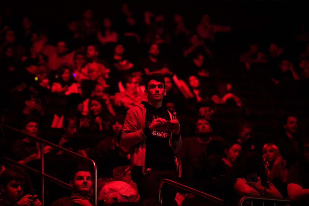 A fan goes to take a photo during the first semifinal match between SK Telecom T1 and ROX Tigers on Friday night at Madison Square Garden. Mark Kauzlarich for TIME