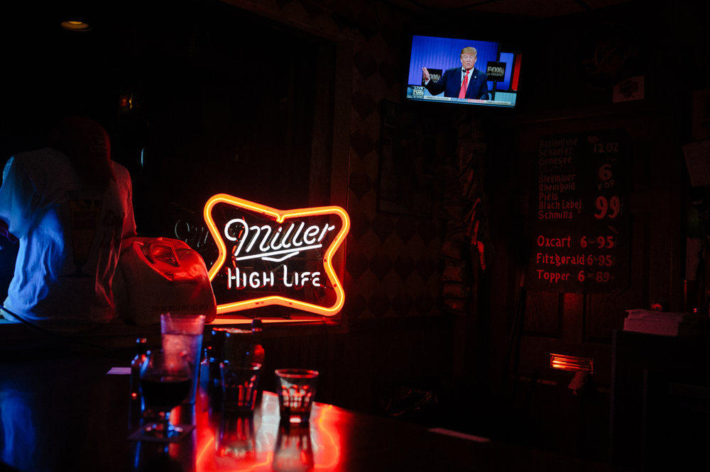 Republican U.S. presidential candidate Donald Trump is seen on television during the Republican debate on FOX Business network as seen at the High Life Lounge in Des Moines, IA.