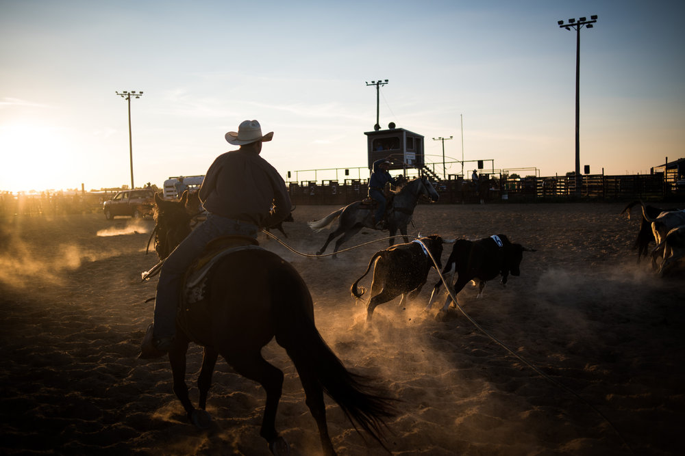 """45º31'27.4""""N, 102º28'11.2""""W. 111 miles from the nearest McDonald's.  Cowboys compete in a ranch rodeo at the Perkins County Fairgrounds in Bison, SD. Ranch rodeos, unlike rodeos shown on television or seen around much of the country, are team events where four riders show their skills as horsemen and ranch hands in activities that would actually be performed on a ranch like trailer loading."""
