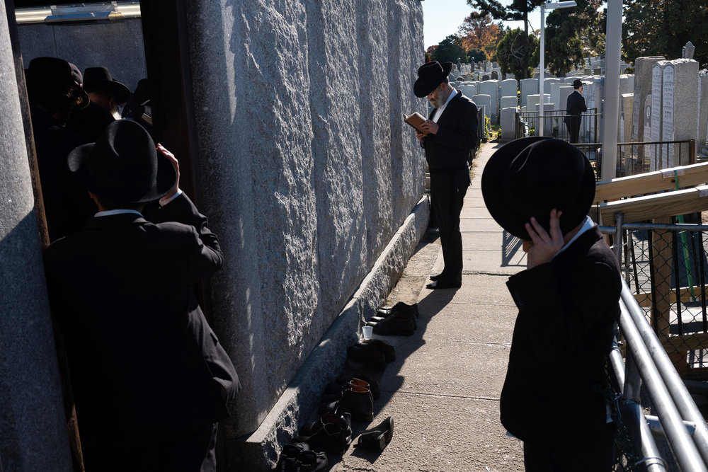 Shoes line the walkway outside Ohel, the gravesite of the Lubavitcher Rebbe Menachem M. Schneerson, as Chabad-Lubavitch rabbis and others gather to pray in Queens, NY.