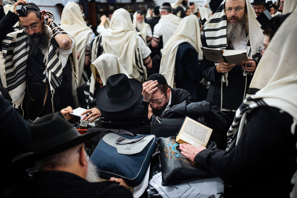 Chabad-Lubavitch rabbis read from prayer books in a building near the gravesite of the Lubavitcher Rebbe, Rabbi Menachem M. Schneerson, in Queens, NY.