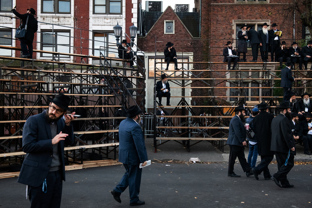 Chabad-Lubavitch rabbis arrive as thousands gather for a group photo in front of the movement's headquarters in the Crown Heights neighborhood of Brooklyn, NY.