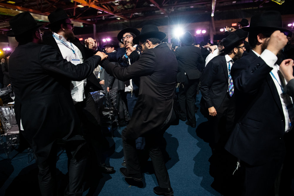 Thousands of Chabad-Lubavitch rabbis and their guests dance after a roll call of all the Chabad emissaries a banquet in Suffern, NY. Each year, the International Conference of Chabad-Lubavitch Shluchim, or emissaries, takes place in the New York City area for six days.