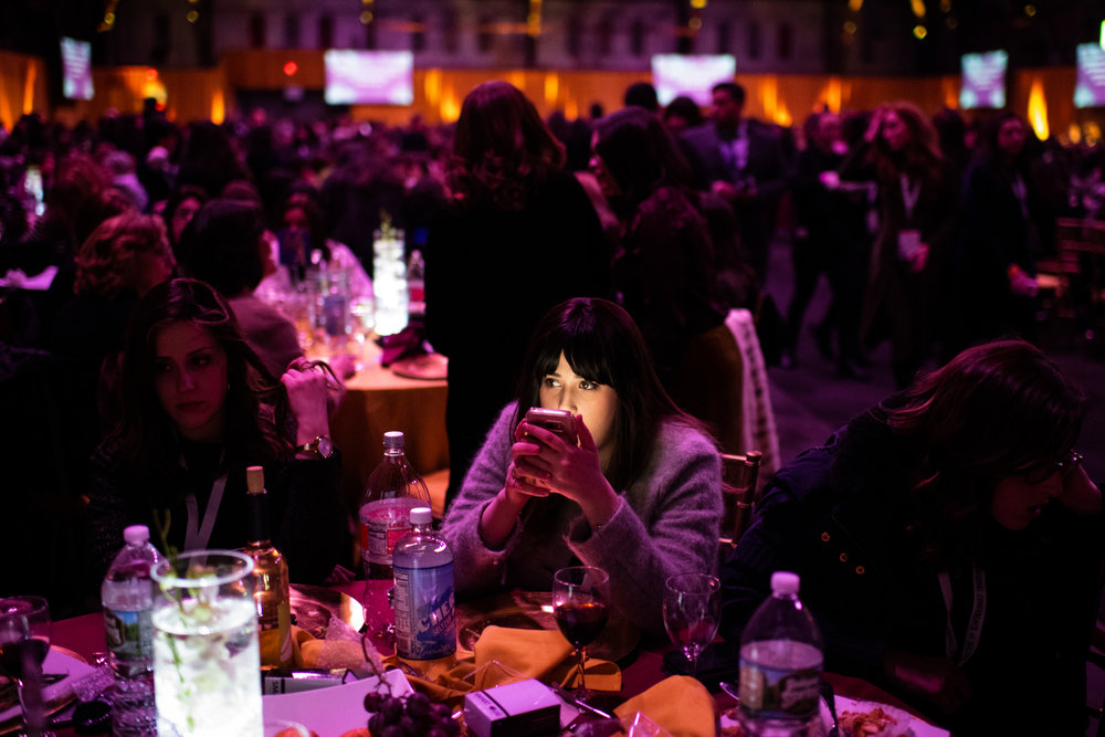 A woman checks her phone after dinner at the Women's Conference of Chabad-Lubavitcher Emissaries in the South Williamsburg neighborhood of New York, NY.