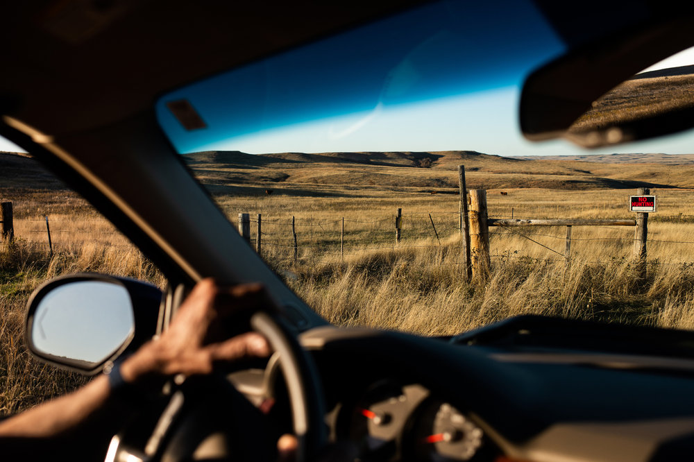 Sion Hanson drives the perimeter of his ranch land's border with National Grassland outside Bison, SD.